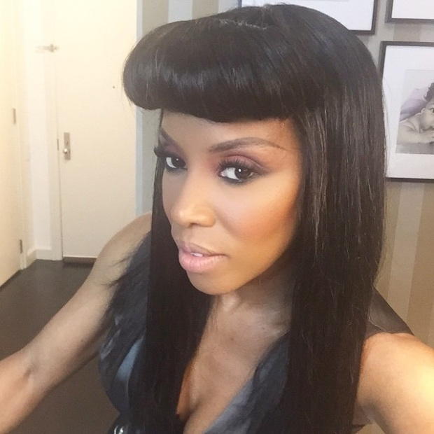 Celebrity Stylist, June Ambrose, rocked heavy bangs with her sleek do.