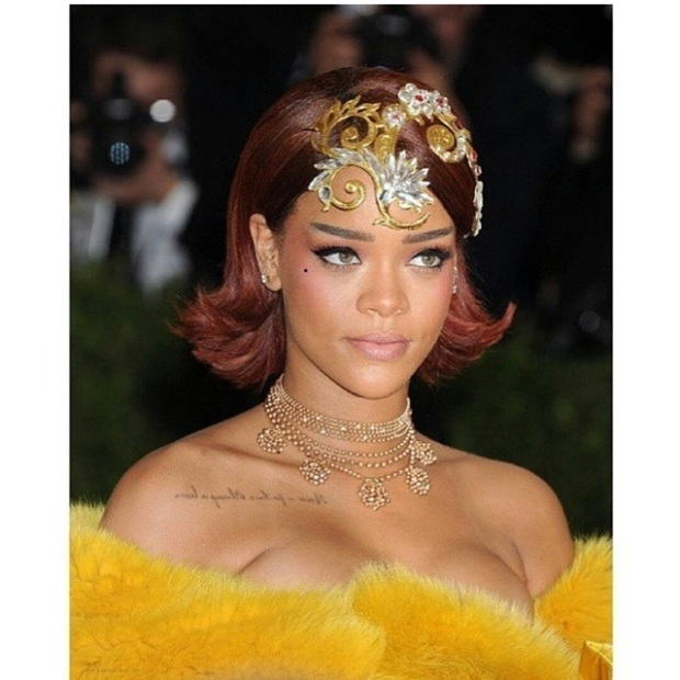 Rihanna was looking very regal with this gold piece